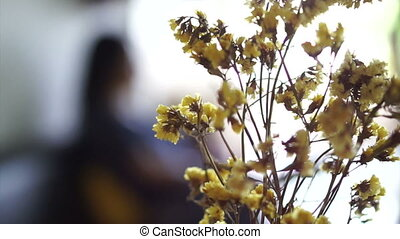 dried yellow flower in coffee shop - dried yellow flower in...
