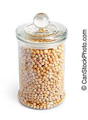 Dried yellow peas in glass jar
