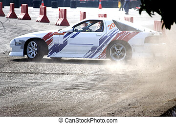 Drift Racing - Drift racing car in action with smoking tyres...