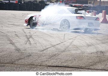 Drift Racing - Drift racing car in action with smoking...