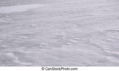 Drift snow on ice in winter blown by heavy wind - Drift snow...