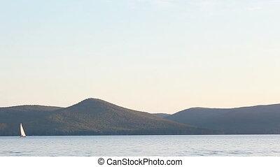 Drifting - Beautiful tranquil scene of sailboat drifting...