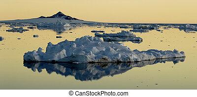 Drifting ice floe at dawn