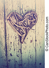 driftwood heart on vintage wall - old heart made of ...