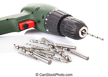Drill and set of drill bits on white
