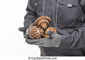 drill bit in hands - Tricone Oil Drill Bits isolated on a...