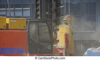 drill machinery working in Construction site & raising the...