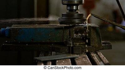 Drill press machine in workshop 4k - Close-up of drill press...