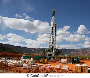 Drill Rig - Drill rig in the Rocky Mountains with Blue Sky...