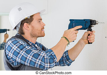 drilling a hole on the wall