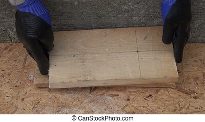 drilling big hole on wooden plank