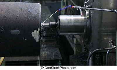 Drilling holes in workpiece on machine