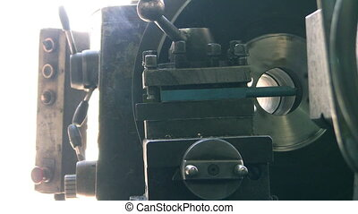 Drilling machine drilling metal.