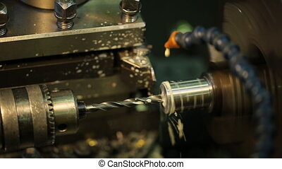 Drilling metal shiny parts on a horizontal milling machine with coolant.