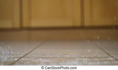 Dringing glass hitting the ground