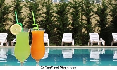 Drink - A pair of glasses with a cocktail on the poolside