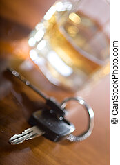 drink and car keys - A set of car keys in the foreground and...