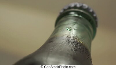Drink Bottle Cold Condensation - Low angle macro shot of a...