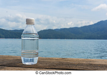 Drink bottle with nature background