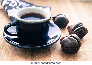 drink cup of coffee with chocolate candies