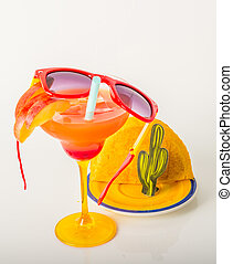 drink decorated with fruit, margarita glass, drink staw and ice cubes, jamaican food, pattie