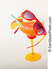 drink decorated with fruit, margarita glass, drink staw and ice cubes