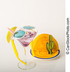 drink decorated with fruit, martini glass, drink staw and ice cubes, jamaican food, pattie