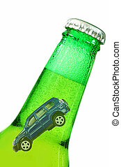 Drink driving concept - Miniature car inside a beer bottle