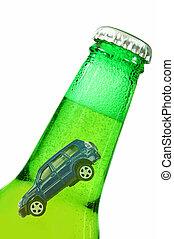 Miniature car inside a beer bottle