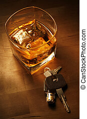 Drink Driving - Whiskey in light pool on brown table with...