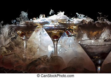 drink in glasses with the effect of dry ice