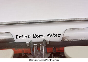 Drink More Water word typed on a Vintage Typewriter