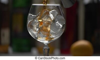 Drink slowly pours into glass.