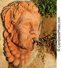 drink water source in tuscan terracotta ,fountain in Garden of roses in Florence, Italy, Europe