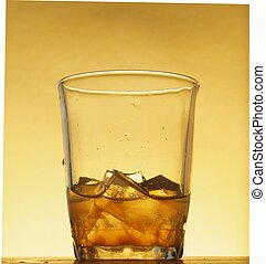 Drink with ice cubes in a glass glass.