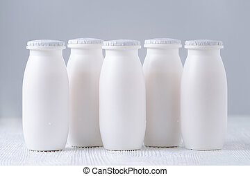 drink yogurt bottles on gray background, dairy product