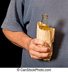 drinker holds a bottle in the paper bag