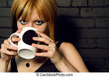 Happy Coffee Drinker And Smiling Female Drinking In An