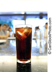 Drinking cola in glass.