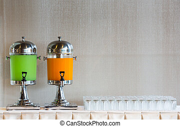 Drinking Dispenser - Drinking dispenser and glass on table...