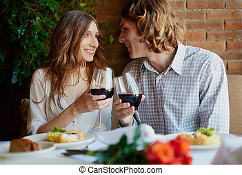 Drinking for love - Portrait of amorous young couple...