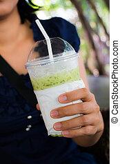 Drinking ice green tea