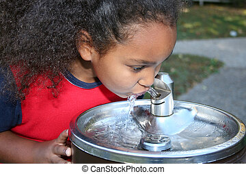 drinking - Adorable five year old African American Girl...