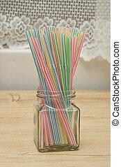 Drinking straws in a bottle