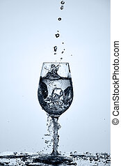 Drinking transparent water is poured into a wineglass...