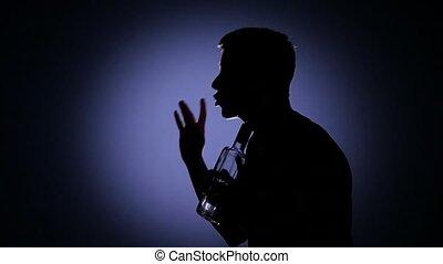 Drinking vodka. Vodka. Back light. Slow motion - Very drunk...