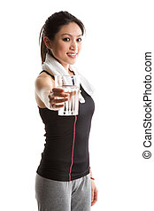 Drinking water - An isolated shot of a healthy asian woman...