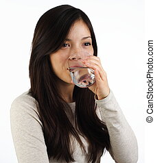 Drinking water - Beautiful young woman drinking water on...