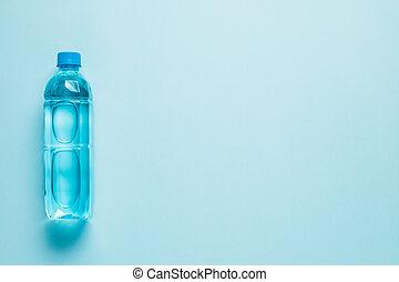 Drinking water bottle on blue background