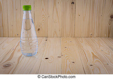 Drinking water bottles on a wooden floor